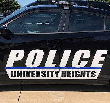 Graphics on side of black police car that read Police, University Heights.